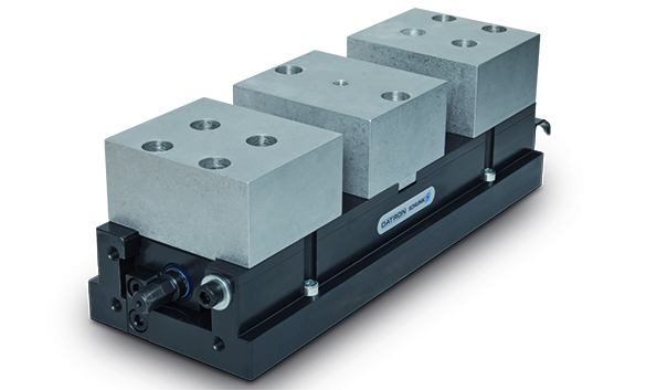 Compact centric clamp CNC workholding is protected from chips and debris through a special slide geometry that helps prevent particle build up and malfunction.