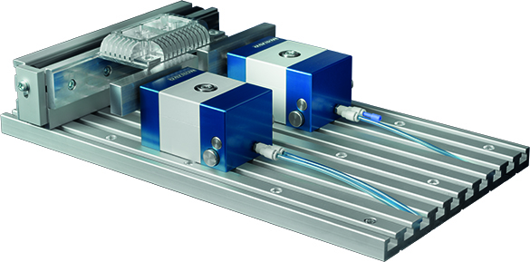 Pneumatic clamp system is CNC workholding that integrates onto the bed of a milling machine or machining center to shorten set up time.