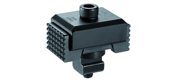 Wedge clamping CNC workholding units add functionality to T-slot tables and allow for adaptable setup.