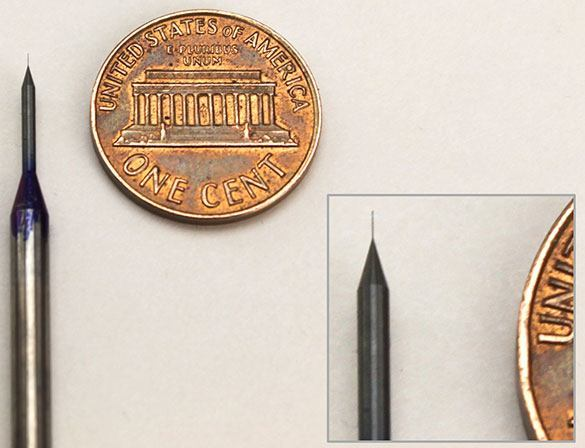 "Micro Drilling Tools can be as small as this 0.0015"" drill shown in comparison to a penny."