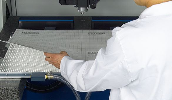 Vacuum table paper called VacuCard is used as a sacrificial layer that allows you to cut completely through the stock without damaging the surface of your vacuum table.
