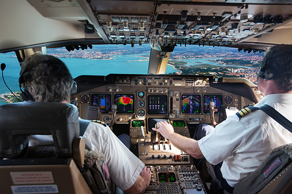 Pilots of a commercial jetliner depend on the illuminated instruments on the control panel of the cockpit.
