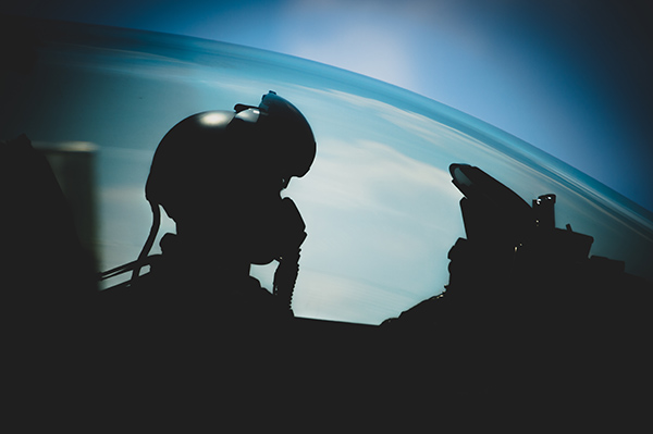A fighter jet pilot relies on illuminated instruments for flying at night.