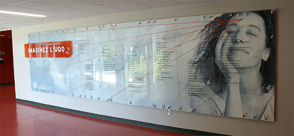 A University Donor Wall shows the use of large acrylic sheet material as well as milled parts in colored acrylic and aluminum.
