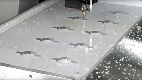 Acrylic sheet on vacuumetable being milled with DATRON CNC mill.